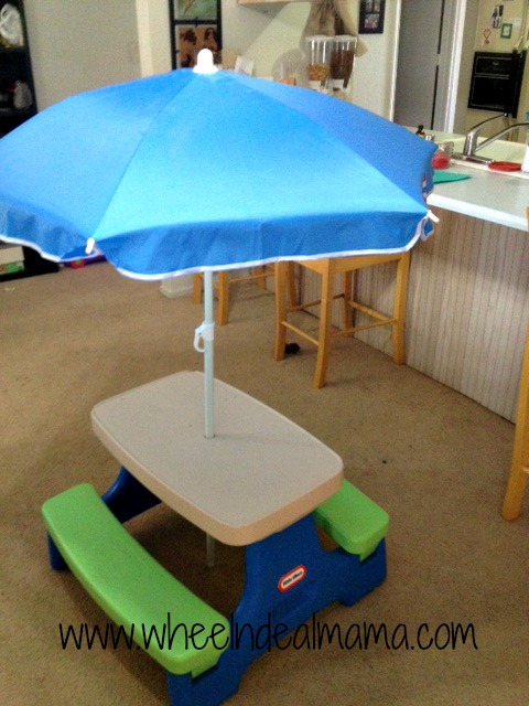 Little tikes easy store jr play table with umbrella review wheel some of you may have noticed the little tikes blog ambassador button on my website i will be working with them to bring my awesome readers some great watchthetrailerfo